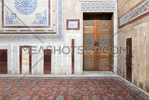 Interior of Al Rifaii Mosque (Royal Mosque) with decorated marble wall and ornate wooden door, located in front the Cairo Citadel, Egypt