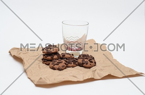An empty glass and chocolate chips cookies