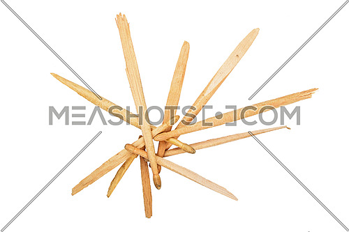 Pieces of broken used wooden drumsticks in shape of star isolated on white background