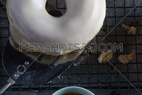 top view of white glazed donut and a bowl of honey