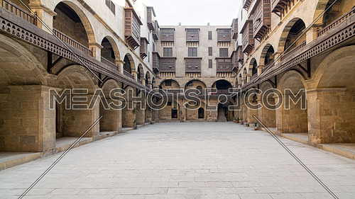 Caravansary (Wikala) of Bazaraa, with vaulted arcades and interleaved wooden grids (mashrabiya), Tombakshia street, Al Gamalia, Cairo, Egypt