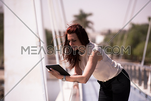 middle eastern business woman with tablet computer in office district