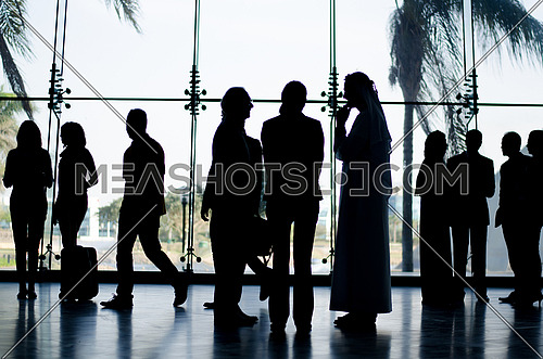 an after business meeting contains several people standing finalizing their deals