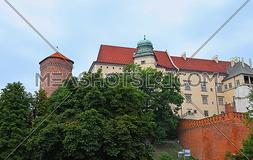 Low angle side view of medieval Wawel Royal Castle, one of most popular tourist attractions and landmarks in Krakow, Poland