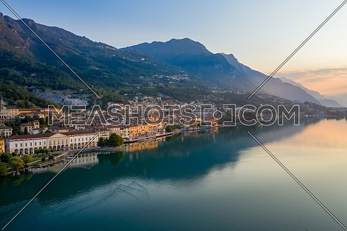 Aerial view of Lake Iseo at sunrise, on the left the city of lovere which runs along the lake,Bergamo Italy.