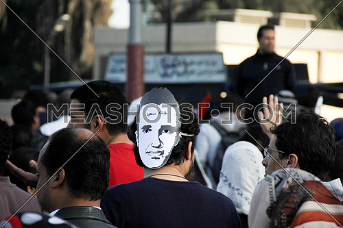 A man from his back wearing khaled said mask in a protest