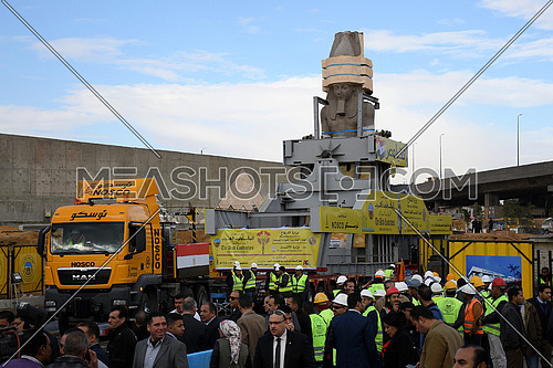 Long shot for The Statue of King Ramses II in the transferring machine at arrival time at the Grand Egyptian Museum in Cairo while people are taking photos for the statue on 25 January 2018