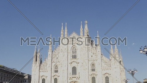Milan, Italy - May 03, 2021: Crowd of tourists in the square in front of the Duomo of Milan, Italy, many people with masks to protect themselves from