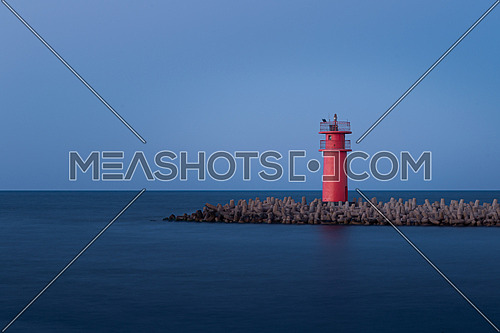 Small red lighthouse, Ras El Bar, Dmietta, Egypt. long exposure shot
