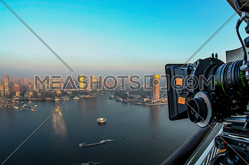 A camera filming a panoramic view of the river nile in cairo egypt