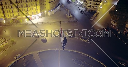 360 shot Drone fly around National Flag Pole at Tahrir Square showing in Cairo at night