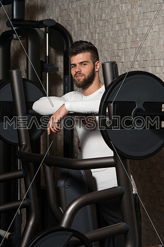 Portrait Of A Physically Fit Young Man Resting In A Health Modern Club