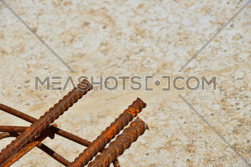 Rusty corroded stained metal pieces of wire, fitting, armature on a dirty concrete floor