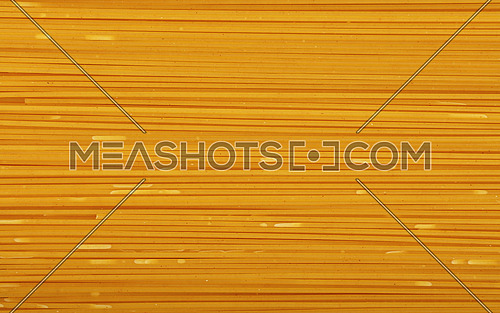 Close up background pattern of spaghetti pasta, elevated top view, directly above
