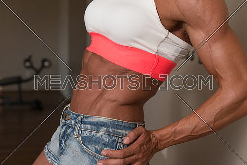 Strong Middle Aged Woman Bodybuilder With Six Pack