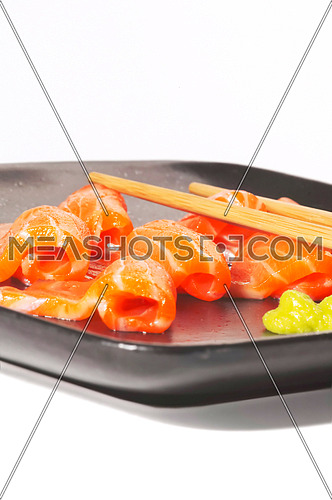 slice of salmon sashimi with wasabi sauce
