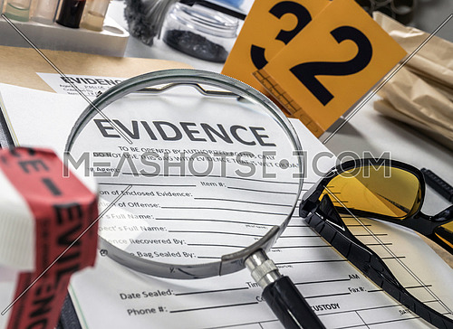 Basic research utensils with a evidence bag in Laboratorio forensic equipment, conceptual image