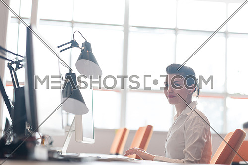 business woman working on desktop computer at modern startup office