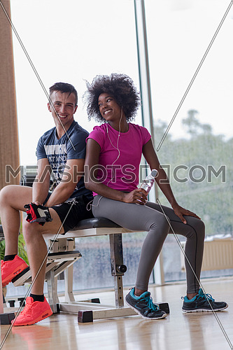 healthy couple have break  at  crossfit gym african  american woman with afro hairstyle
