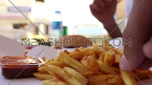 Eating fries with a sauce