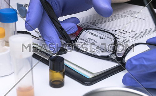 Scientist analyzes listeria sample in laboratory, conceptual image