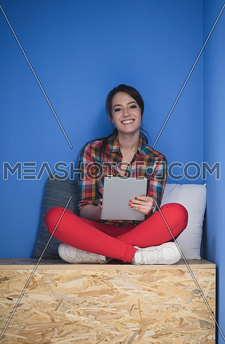 young woman in crative box working on tablet computer, startup business modern office room  interior