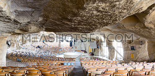 Cairo, Egypt - December 18 2016: Hall at St. Samaan the Tanner Monastery with murals engraved on the rocks representing scenarios from the Bible