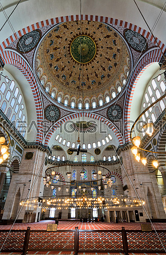 Interior low angle shot of Suleymaniye Mosque, an Ottoman imperial mosque built in 1557, located on the Third Hill of Istanbul, Turkey, and the second largest mosque in the city