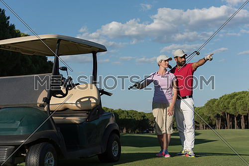 portrait of happy young  golfers couple on golf course