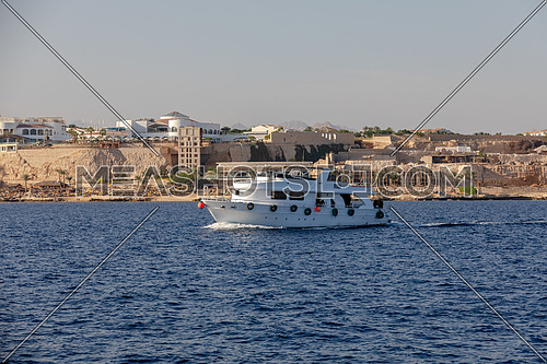 Long shot for yacht sailing showing Sharm El Shaikh City by day