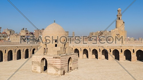 Courtyard of Ibn Tulun public historical mosque with ablution fountain and the minaret, Sayyida Zaynab district, Medieval Cairo, Egypt