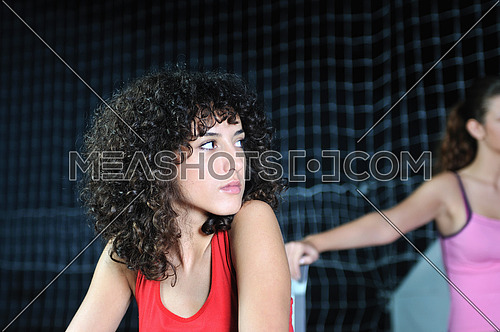 young woman rerlaxing fitness and working out in a gym