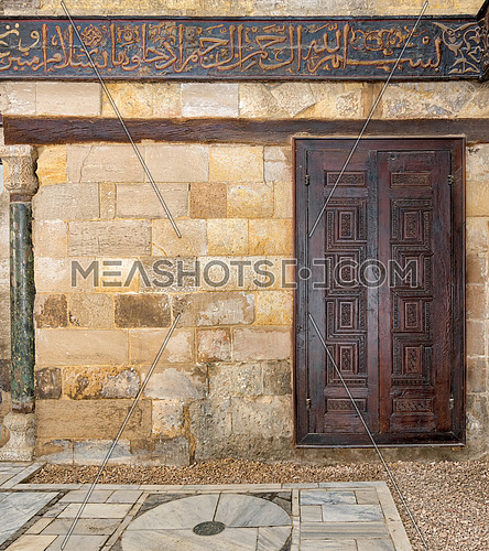 Wooden ornate door over stone wall at the Mausoleum of al-Salih Nagm Ad-Din Ayyub, Cairo, Egypt