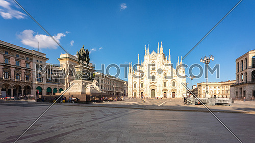 """Long exposure of Milan cathedral Duomo and Vittorio Emanuele statue in Square """"Piazza Duomo"""" at sunny day, Milan, Italy."""