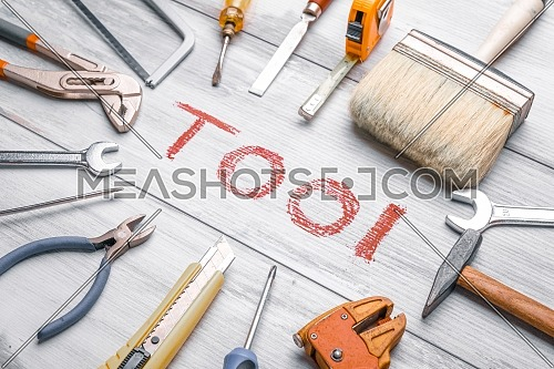Set of work tool on rustic wooden background with written