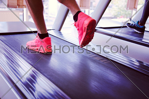 healthy yung sportsman exercise jogging on treadmill in fitness gym