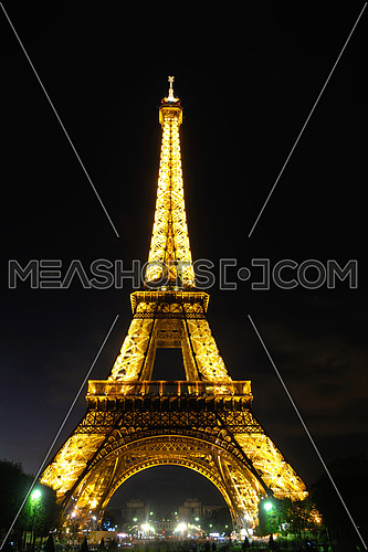 eiffel tower in paris at night tourist and travel icon and attraction