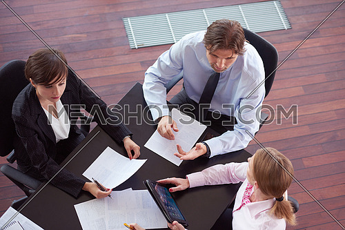 top view of  business people group on meeting, working in modern bright office indoor with tablet computer