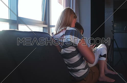 Mother And Daughter Using Tablet Computer at home