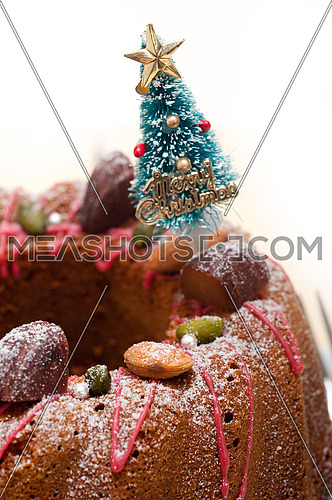 Christmas cake donut with tree as festive decoration on top over white background