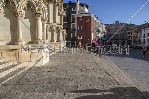 CUENCA, SPAIN - August 24, 2016: Tourists walk near the facade of the Cuenca's Cathedral, The cathedral is dedicated to St Julian, gothic english-norman style, XII century, called the Basilica of Our Lady of Grace, take in Cuenca, Spain