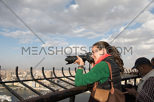 famale tourist taking photos from cairo tower at beautiful sunny day