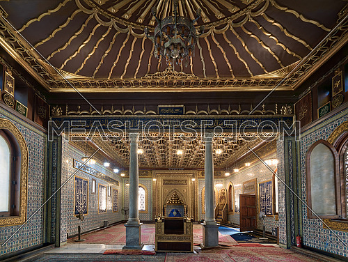 Interior of public mosque of Manial Palace of Prince Mohammed Ali Tewfik with wooden golden ornate ceilings with design based on old logo of the ottoman empire, Cairo, Egypt