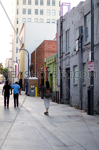 walking people / passengers  on a side alley in the street
