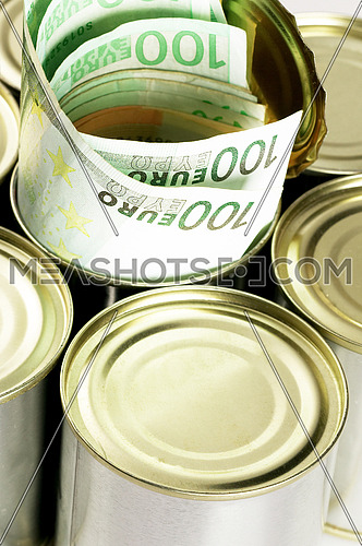 euro bills on a tin can over white background