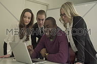 Professionals Looking at Laptop