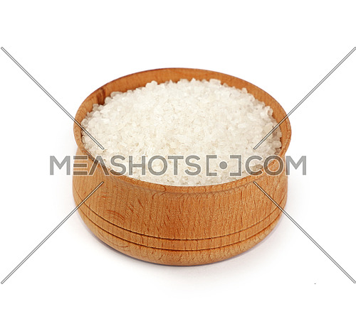 Close up one wooden bowl full of white marine rock salt isolated on white background, high angle view