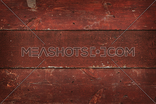 Close up background texture of dark, red vintage painted wooden planks, rustic style wall panel
