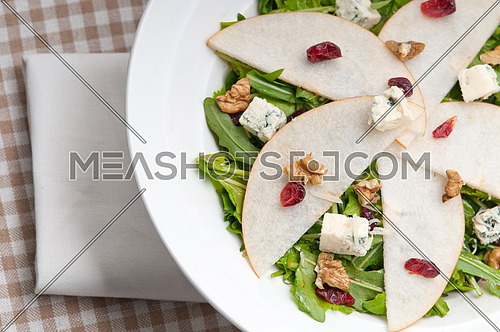 Fresh pears arugula gorgonzola cheese salad with cranberry and walnuts