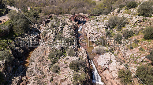 Roman Bridge of Vadollano, which is part of the route of the route Augusta, enclave of special scenic and historical interest, because to the beauty of the route of the Guarrizas River, Linares, Jaen Province, Spain